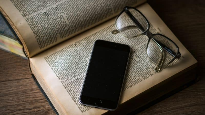 Smartphone and Regular Reading Glasses on Book