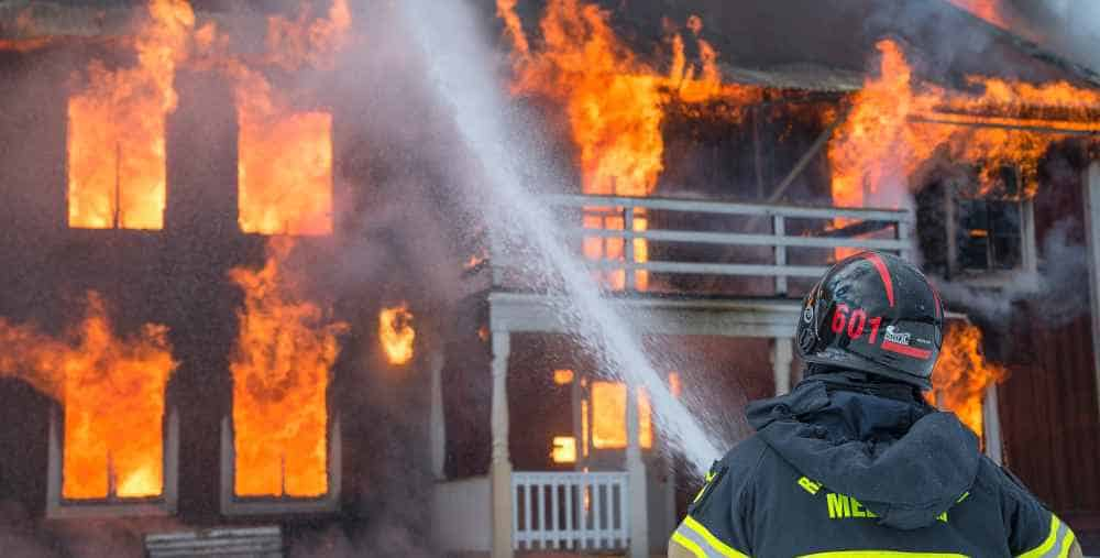Firefighter Near a Burning Building