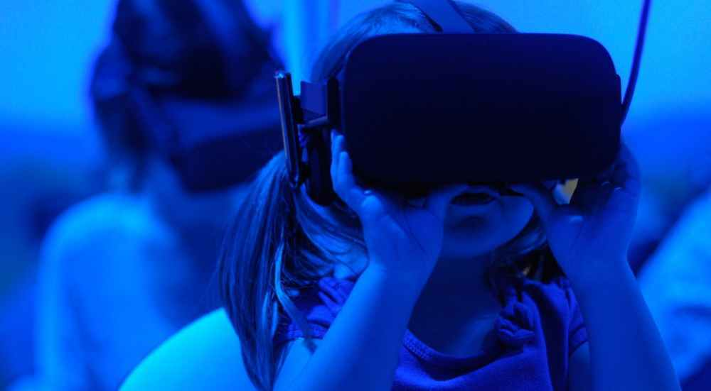 Small Girl Using VR Goggles