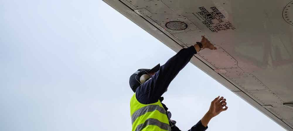 Man doing maintenance works on a plane