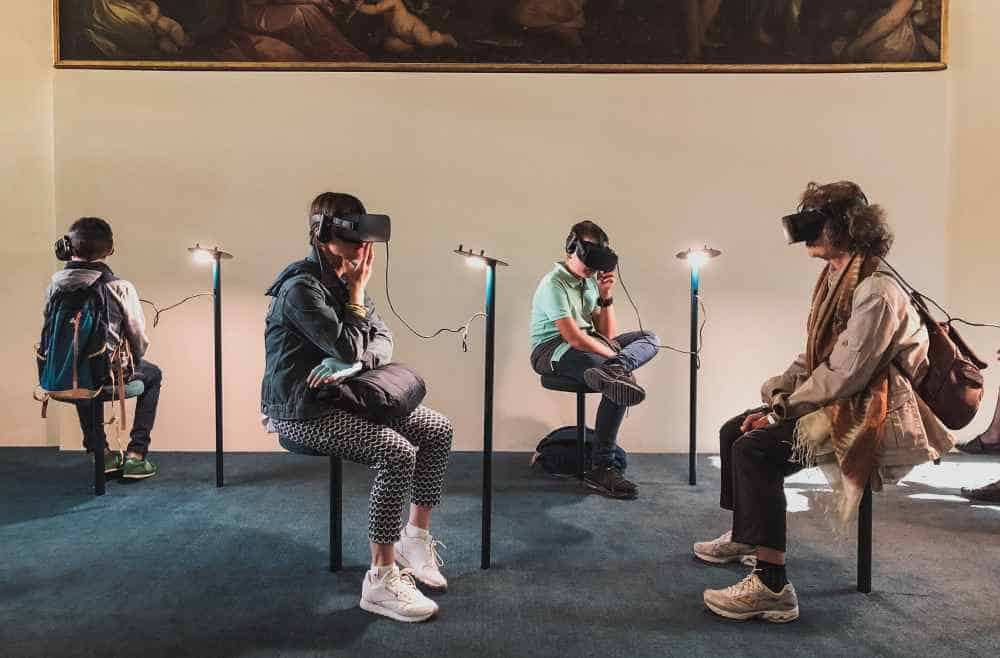 People Using VR Headsets In a Museum Exhibition